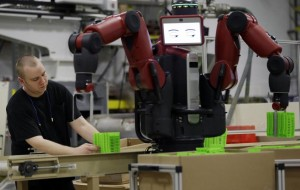 Man working with factory automation equipment