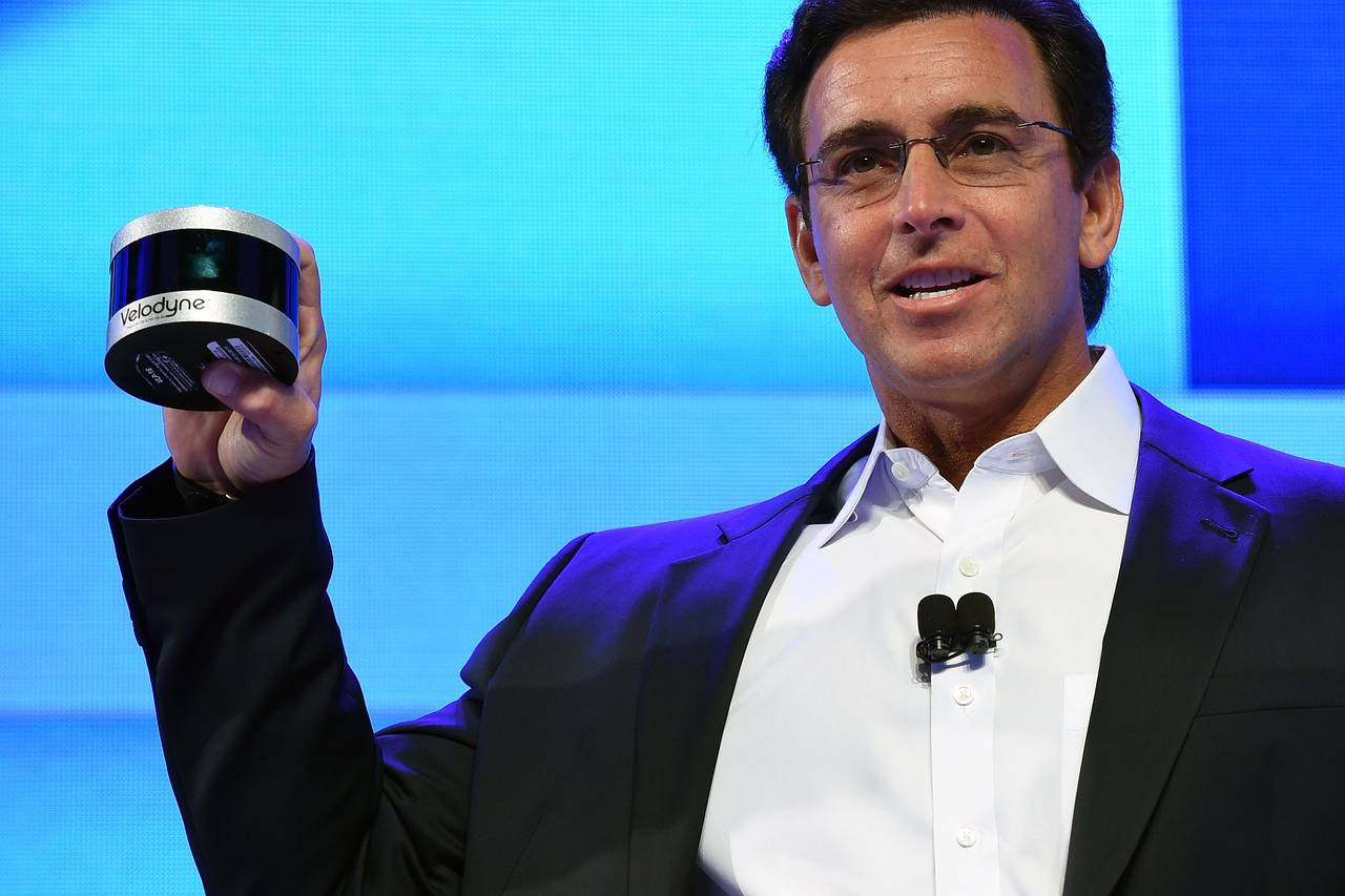 Automotive executive giving presentation on driverless car