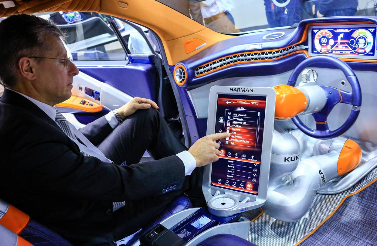 Man in concept car using tablet